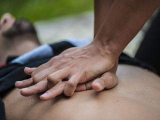 Man having CPR performed on chest.